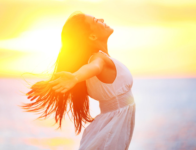 Enjoyment - free happy woman enjoying sunset. Beautiful woman in