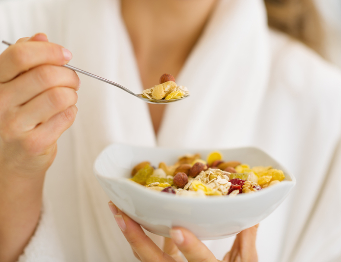 Closeup On Woman In Bathrobe Eating Healthy Breakfast