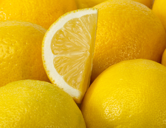 Background Of Yellow Ripe Lemons.