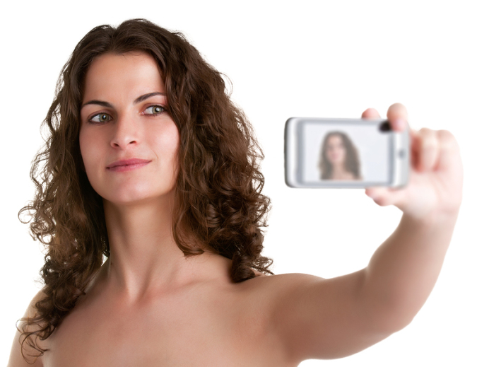 Woman Taking A Picture With A Cell Phone